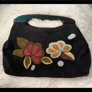 Fossil Boho suede flower patched wooden handle bag
